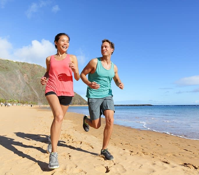 bigstock Runners running on beach Jogg 90536186 e1512926705458