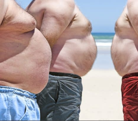 three obese men on the beach