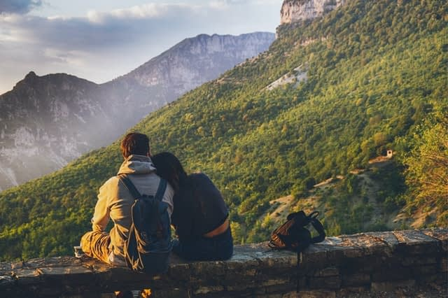 couple on hike on the mountains