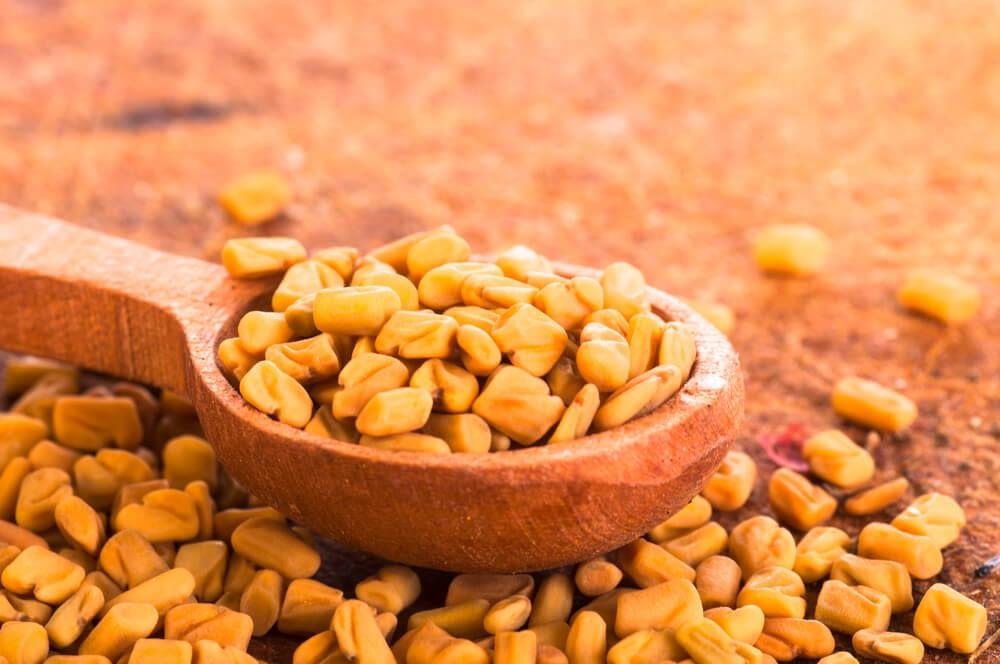 fenugreek seeds in wooden spoon