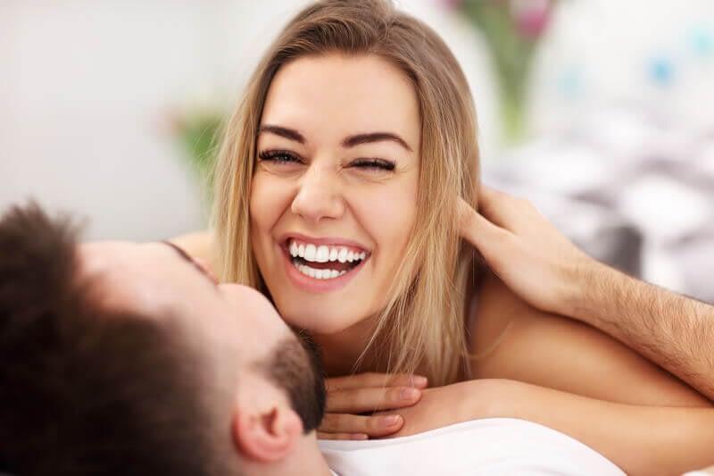 happy couple in bed having sex