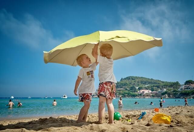kids playing on sunny beach