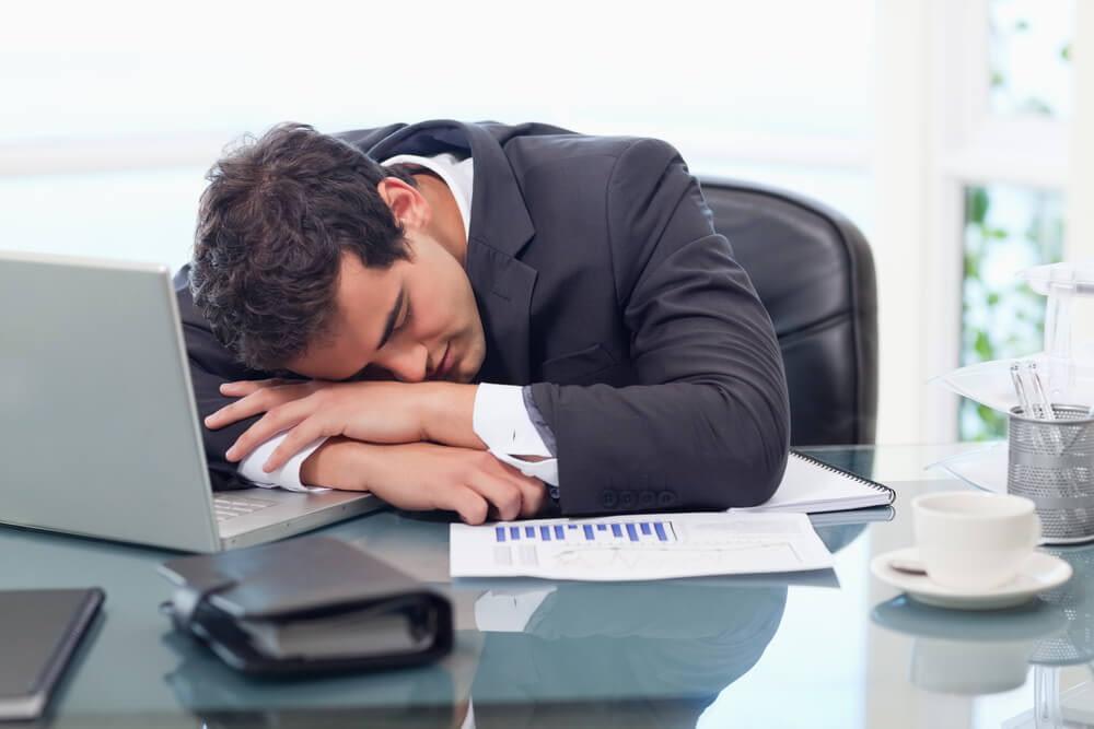 man feeling terrible due to lack of sleep
