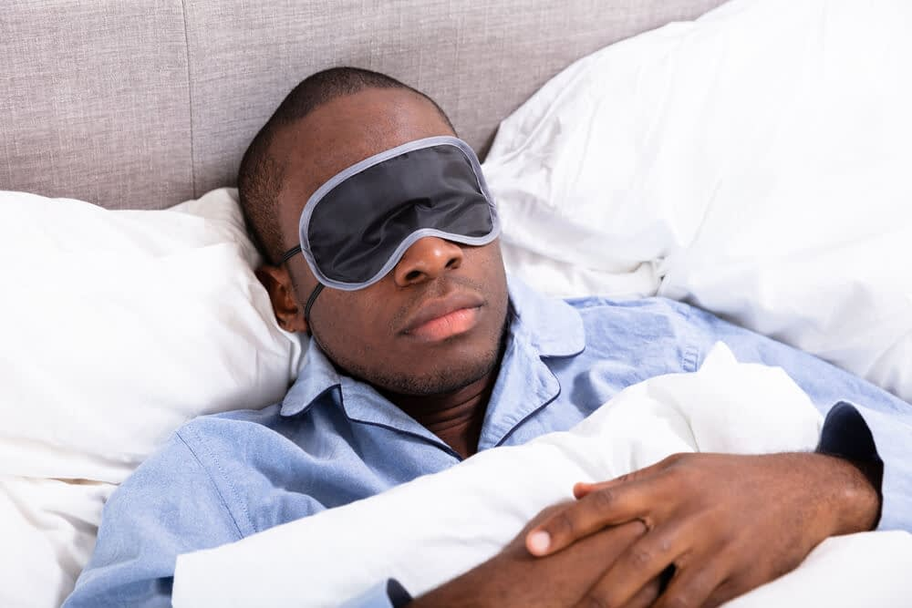 man sleeping with mask
