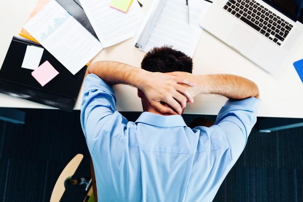 man stressing at work