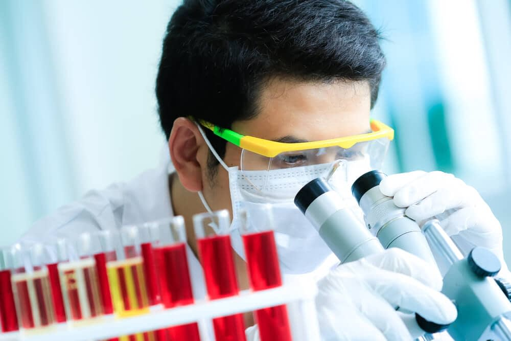 researcher analyzing link between vitamin d and testosterone