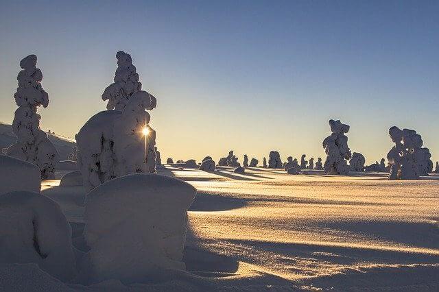 snowy winter landscape with sun